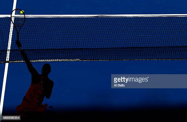 Petra Kvitova of the Czech Republic returns a shot to Anna Karolina Schmiedlova of Slovakia during their Women's Singles Third Round match on Day Six...