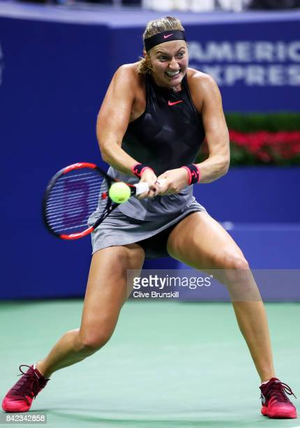Petra Kvitova of the Czech Republic returns a shot to Garbine Muguruza of Spain during their fourth round Women's Singles match between on Day Seven...