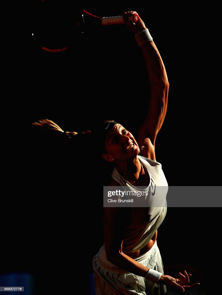 Petra Kvitova of the Czech Republic serves against Lesia Tsurenko of the Ukraine in their first round match during day two of the Mutua Madrid Open tennis tournament at the Caja Magica on May 6, 2018 in Madrid, Spain.