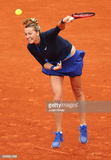 Petra Kvitova of the Czech Republic serves during the Ladies Singles first round match against Danka Kovinic of Montenegro on day one of the 2016...