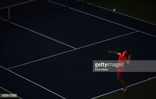 Petra Kvitova of the Czech Republic serves to Catherine Bellis of the United States during their quarterfinal match on Day 5 of the Bank of the West...