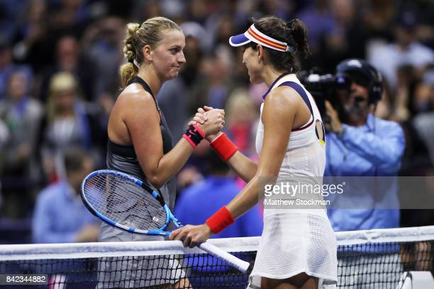 Petra Kvitova of the Czech Republic shakes hands with Garbine Muguruza of Spain after defeating her during their fourth round Women's Singles match...