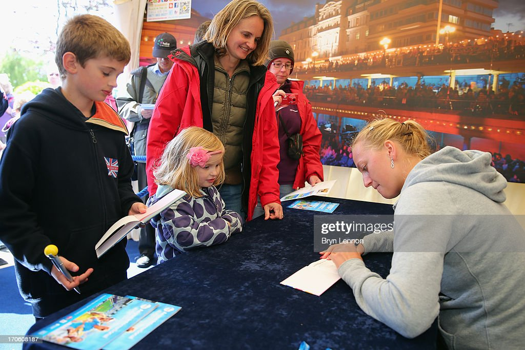 Petra Kvitova of the Czech Republic signs autographs during day one of the Aegon Interantional at Devonshire Park on June 15, 2013 in Eastbourne, England.