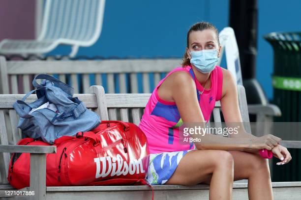 Petra Kvitova of the Czech Republic sits on a bench outside of Arthur Ashe stadium after losing during her Women's Singles fourth round match against...