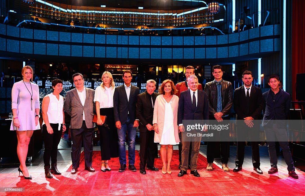 Petra Kvitova of the Czech Republic,Carla Suarez Navarro of Spain,Maria Sharapova of Russia,Rafael Nadal of Spain, Tomas Berdych of the Czech Republic,Milos Raonic of Canada,Stanislas Wawrinka of Switzerland and Kei Nishikori of Japan pose for a photograph with officials at the player party during day two of the Mutua Madrid Open tennis tournament at the Caja Magica on May 3, 2015 in Madrid, Spain.