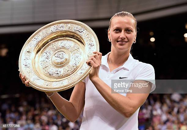Petra Kvitova poses with the Venus Rosewater Dish after beating Eugenie Bouchard in the ladies singles final on centre court during day twelve of the...
