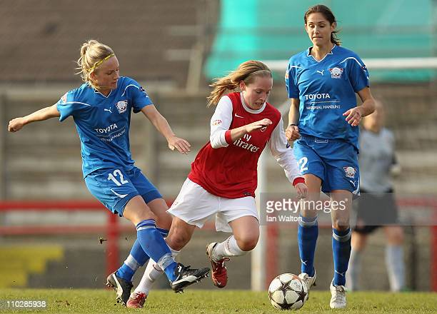 Petra Larsson of Linkopings tries to tackle Kim Little of Arsenal during the UEFA Women's Champions League Quarter Final match between Arsenal and...