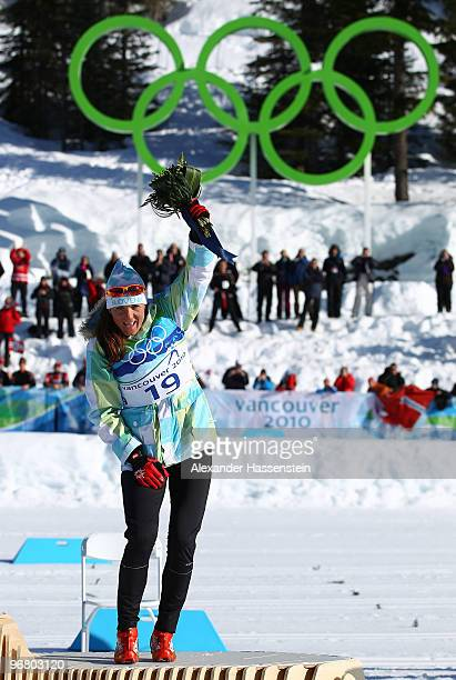 Petra Majdic of Slovenia celebrates on the podium after winning the bronze medal during the flower ceremony for the Women's Individual Sprint C Final...