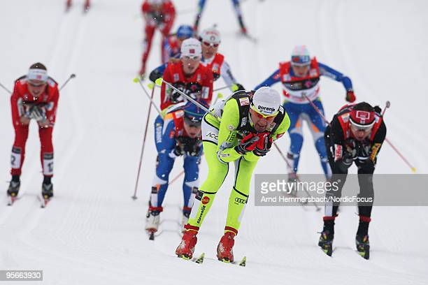 Petra Majdic of Slovenia leads the top group behind competes Aino Kaisa Saarinen of Finland and Justyna Kowalczyk of Poland during the mass women for...