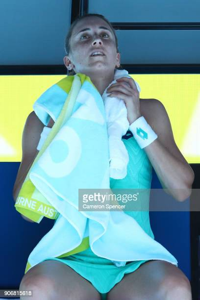Petra Martic of Croatia attempts to cool down between games in her third round match against Luksika Kumkhum of Thailand on day five of the 2018...