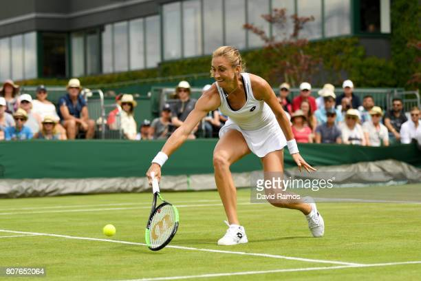 Petra Martic of Croatia plays a backhand during the Ladies Singles first round match against Daria Gavrilova of Australia on day two of the Wimbledon...