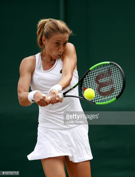 Petra Martic of Croatia plays a backhand during the Ladies Singles third round match against Zarina Diyas of Kazakhstan on day six of the Wimbledon...