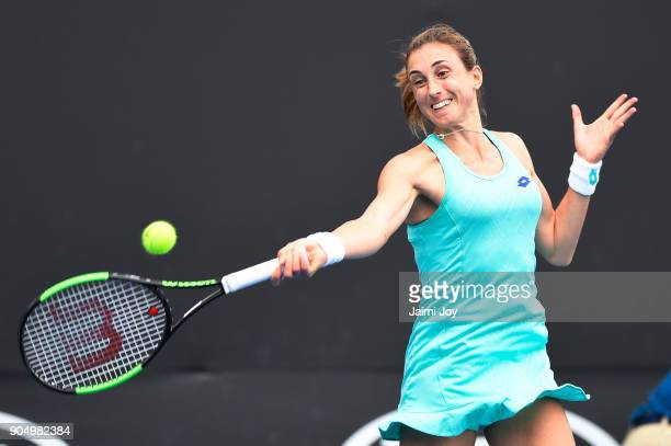 Petra Martic of Croatia plays a forehand in her first round match against Alison Van Uytvanck of Belgium on day one of the 2018 Australian Open at...