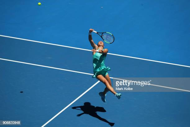 Petra Martic of Croatia plays a forehand in her third round match against Luksika Kumkhum of Thailand on day five of the 2018 Australian Open at...
