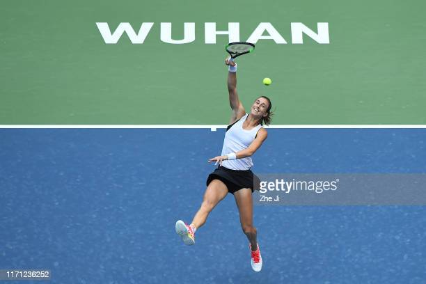 Petra Martic of Croatia returns a shot during the match against Ashleigh Barty of Australia on Day 5 of 2019 Dongfeng Motor Wuhan Open at Optics...