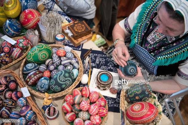 Petra Nakoinz paints an Easter egg during the annual Sorbian Easter egg market at the Sorbian cultural center on March 17 2018 in Schleife Germany...