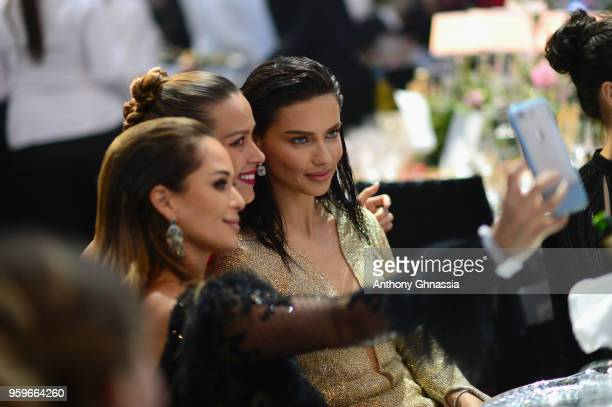 Petra Nemcova and Adriana Lima attend the amfAR Gala Cannes 2018 dinner at Hotel du CapEdenRoc on May 17 2018 in Cap d'Antibes France