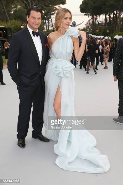 Petra Nemcova and Alejandro Grimaldi arrive at the amfAR Gala Cannes 2017 at Hotel du CapEdenRoc on May 25 2017 in Cap d'Antibes France