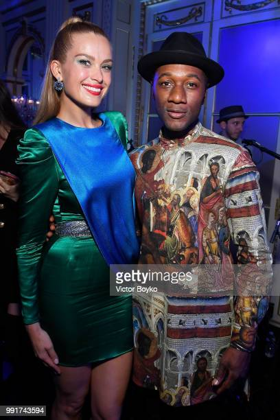 Petra Nemcova and Aloe Blacc pose during amfAR Paris Dinner 2018 at The Peninsula Hotel on July 4 2018 in Paris France