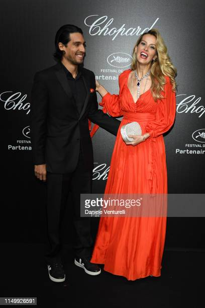 Petra Nemcova and Benjamin Larretche attend the Chopard Love Night photocall on May 17 2019 in Cannes France