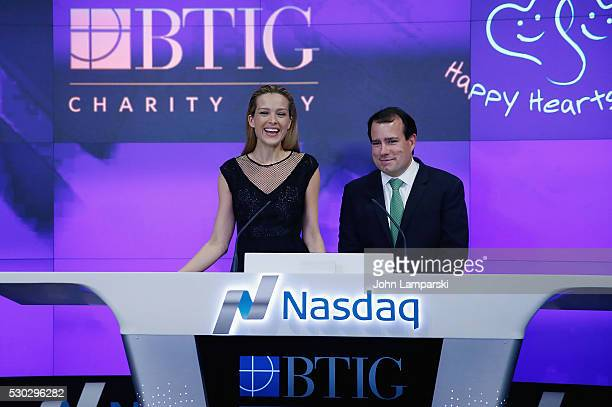 Petra Nemcova and BTIG Managing Director Peter Terran ring Nasdaq Closing Bell for Charity Day at NASDAQ on May 10 2016 in New York City