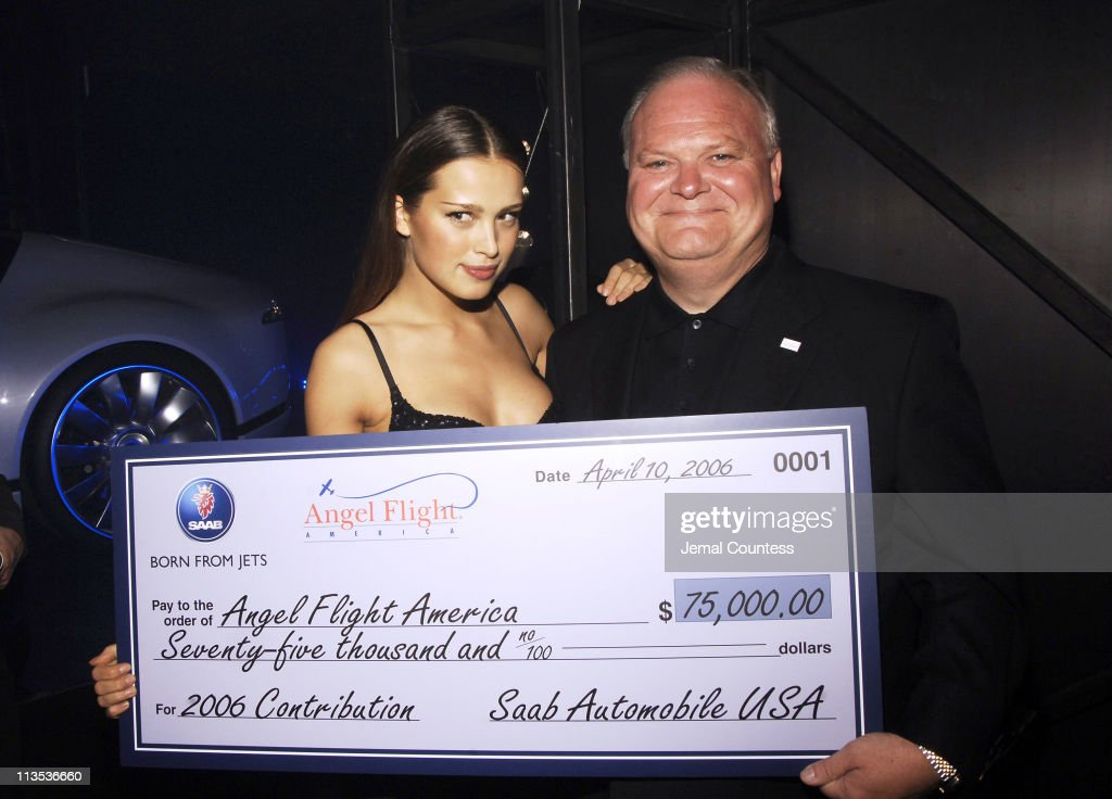 Petra Nemcova and Butch Smith of SAAB with a $70,000 check donated to Angel Flight America