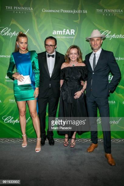 Petra Nemcova and Caroline Scheufele attend the amfAR Paris Dinner 2018 at The Peninsula Hotel on July 4 2018 in Paris France