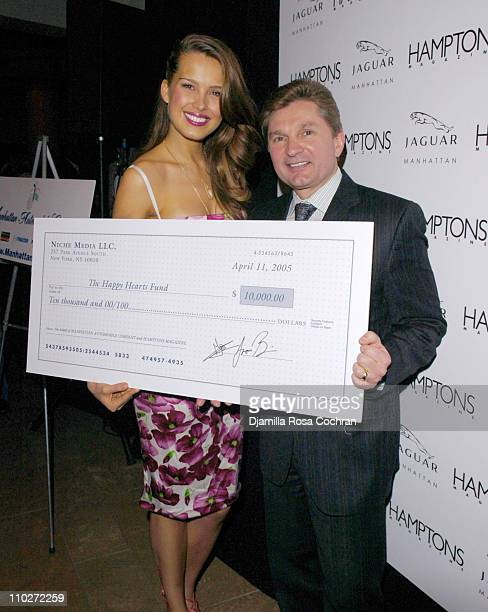 Petra Nemcova and Gary Flom President and CEO of Manhattan Automobile Company presenting check for the Happy Hearts Fund