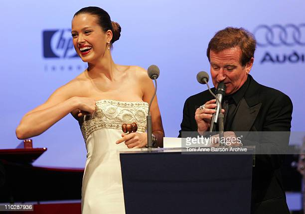 Petra Nemcova and Robin Williams during amfAR's Cinema Against AIDS Benefit in Cannes, Presented by Bold Films, Palisades Pictures and The Weinstein...