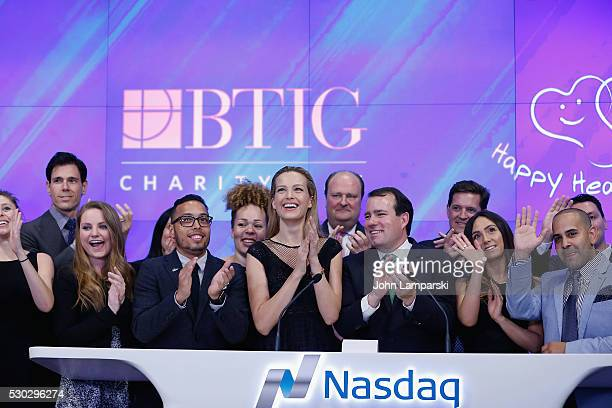 Petra Nemcova BTIG Managing Director Peter Terrant and VP of NASDAQ David Wicks ring Nasdaq Closing Bell for Charity Day at NASDAQ on May 10 2016 in...