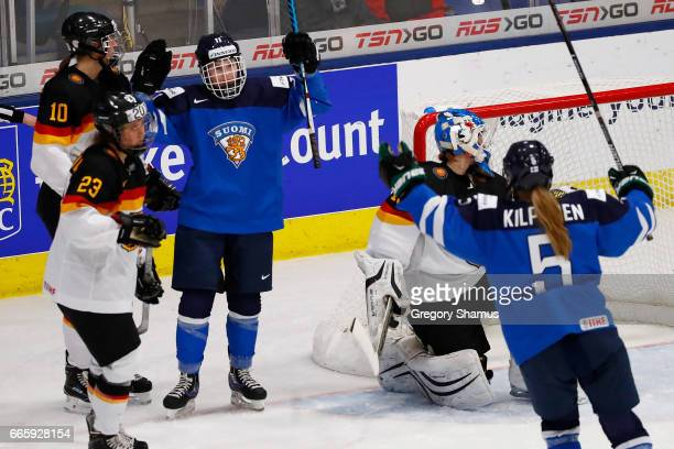 Petra Nieminen of Finland celebrates a second period goal with Anna Kilponen next to Ivonne Schroder of Germany in the bronze medal game at the 2017...