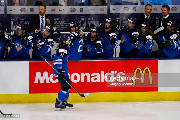 Petra Nieminen of Finland celebrates her first period goal with teammates while playing Germany in the bronze medal game at the 2017 IIHF Woman's...