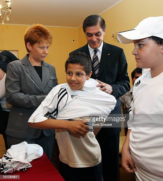 Petra Pau vice president of the German Bundestag and Romani Rose head of the Central Council of Romani people in Germany hand over a DFB starter kit...