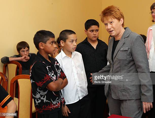 Petra Pau vice president of the German Bundestag talks to pupils during a school visit where members of the German football association and Romani...