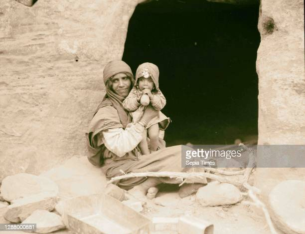 Petra. Petrean types, etc. Bdul Bedouins. Mother and baby before their cave home in ed-Der Valley. 1920, Jordan, Petra .