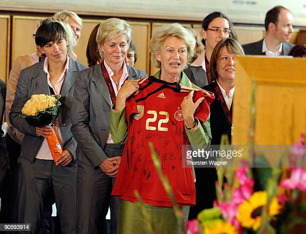 Petra Roth major of Frankfurt receives a shirt with autographs during the Womens national team celebration of the Euro 2009 victory at the Frankfurt...