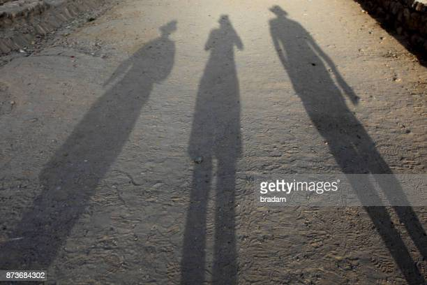 Petra Shadows of people on path to the Siq