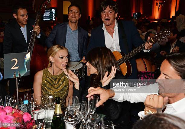 Petra Stunt Tamara Ecclestone and Jay Rutland listen to Didier Casnati and The Gypsy Queens at The F1 Party in aid of the Great Ormond Street...