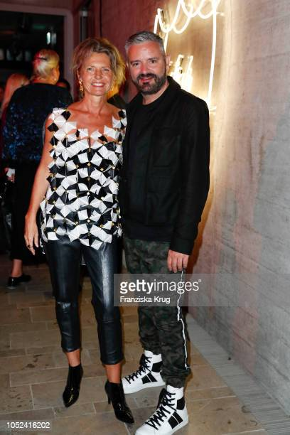 Petra Wilma Mayer and fashion designer Adrian Runhof attend the Dom Perignon 'The Legacy' on October 17 2018 in Munich Germany