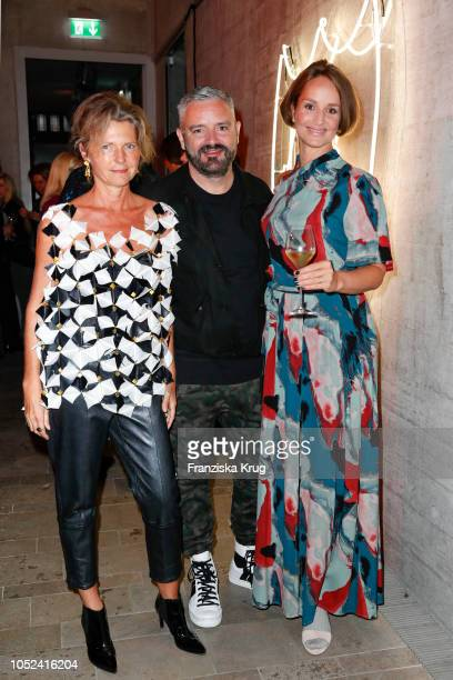 Petra Wilma Mayer fashion designer Adrian Runhof and Lara Joy Koerner attend the Dom Perignon 'The Legacy' on October 17 2018 in Munich Germany