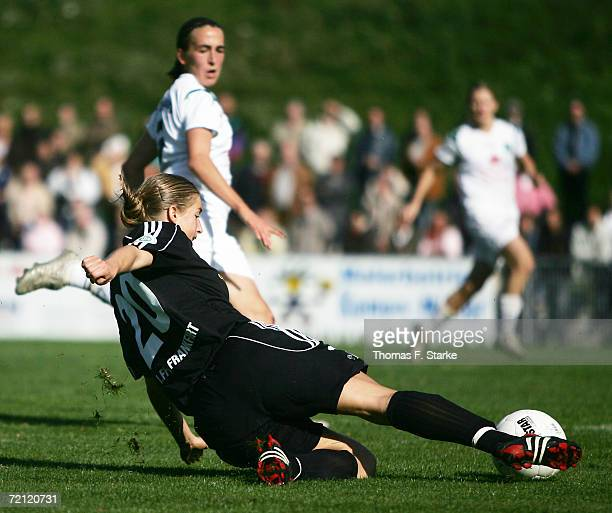 Petra Wimbersky of Frankfurt kicks the ball while Anne van Bonn looks on during the Women's Bundesliga match between FCR 2001 Duisburg and 1 FFC...