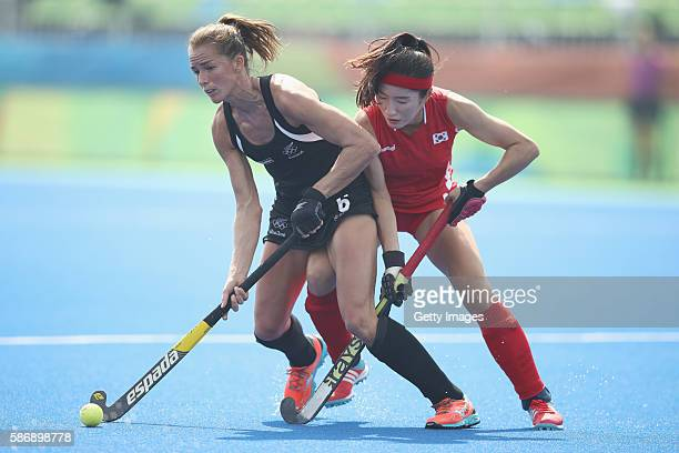 Petrea Webster of New Zealand Hyoju An of Korea compete for the ball during the women's pool A match between New Zealand and the Republic of Korea on...