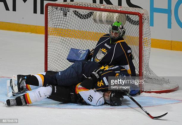 Petri Kokko of Espoo Blues and Ramzi Abid of SC Bern fight for the puck during the IIHF Champions Hockey League match between Espoo Blues and SC Bern...