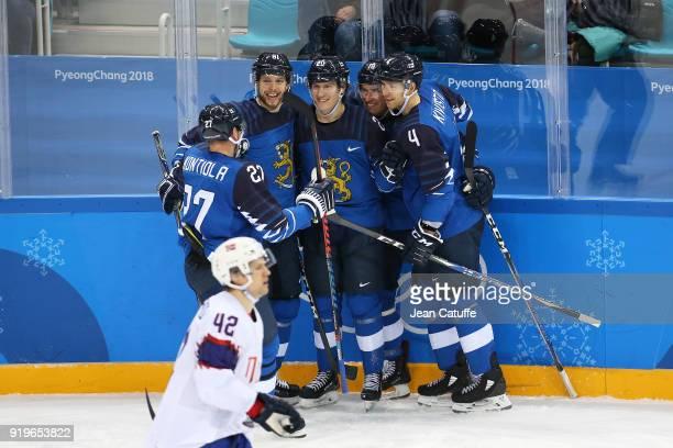 Petri Kontiola Jukka Peltola Eeli Tolvanen Sami Lepisto and Tommi Kivisto of Finland celebrate during the Men's Ice Hockey Preliminary game between...