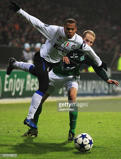 Petri Pasanen of Bremen and Jonathan Biabiany of Milano battle for the ball during the UEFA Champions League group A match between SV Werder Bremen...