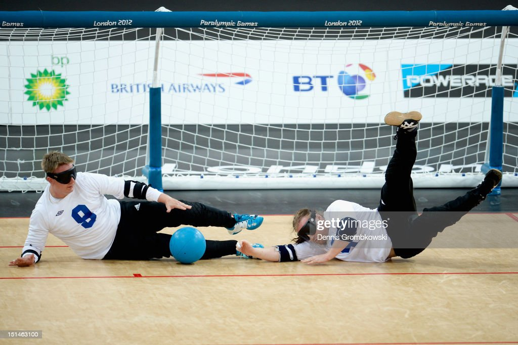 Petri Posio of Finland and teammate Erkki Miinala block the ball during their Men's Team Goalball Bronze Medal match between against Brazil on day 9 of the London 2012 Paralympic Games at The Copper Box on September 7, 2012 in London, England.
