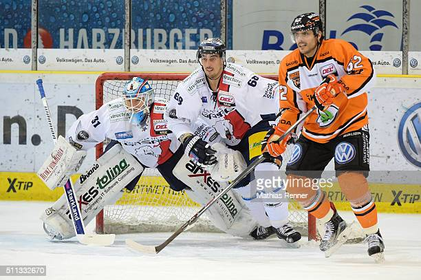Petri Vehanen Milan Jurcina of the Eisbaeren Berlin and Daniel Widing of Grizzlys Wolfsburg during the game between Grizzlys Wolfsburg and Eisbaeren...