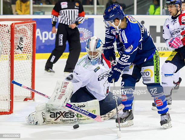 Petri Vehanen of the Eisbaeren Berlin and Mike Connolly of Straubing Tigers during the game between the Straubing Tigers and the Eisbaeren Berlin on...