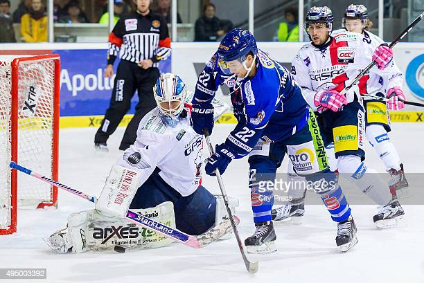 Petri Vehanen of the Eisbaeren Berlin and Mike Connolly of Straubing Tigers and Jens Baxmann of the Eisbaeren Berlin during the game between the...