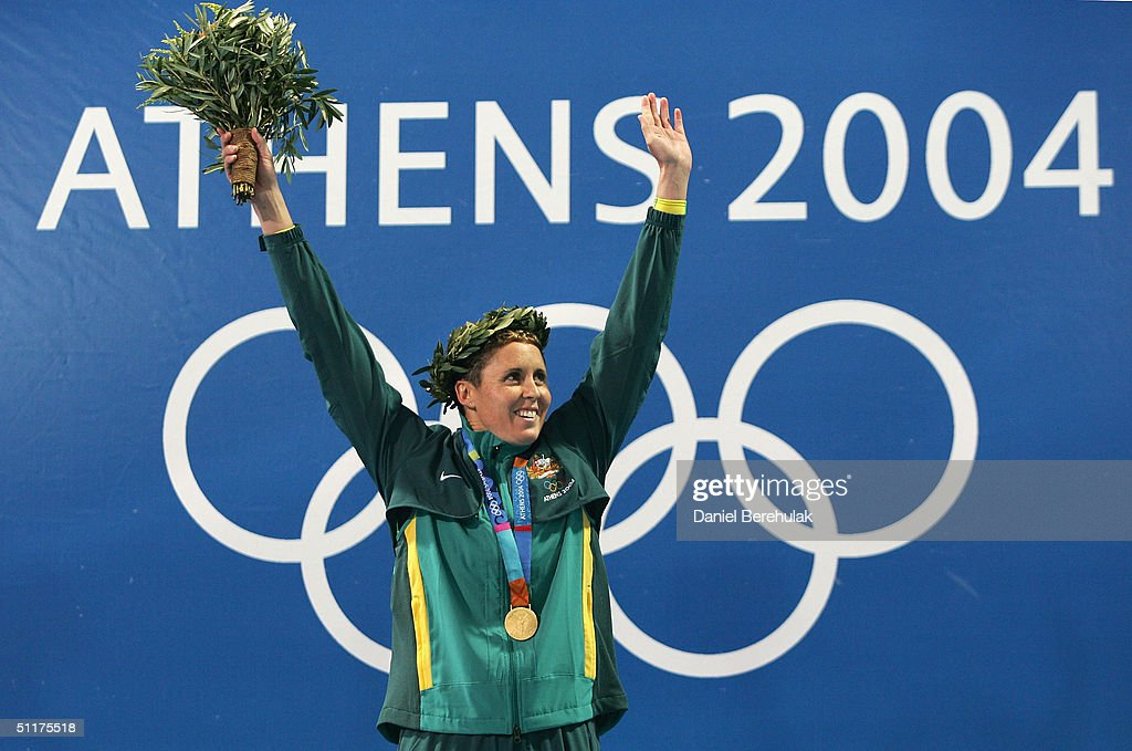 Petria Thomas of Australia holds her gold medal for the women's swimming 100 metre butterfly final on August 15, 2004 during the Athens 2004 Summer Olympic Games at the Main Pool of the Olympic Sports Complex Aquatic Centre in Athens, Greece.